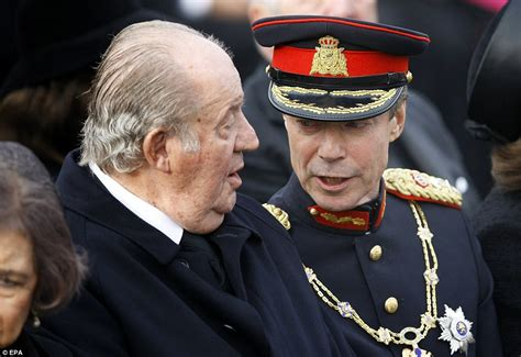 Prince Charles pays his respects to Romania's late king