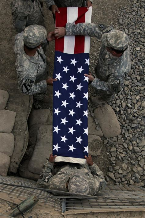 DVIDS - Images - Soldiers fold flag for reenlistment