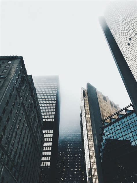 high-rise buildings covered with fog photo – Free City